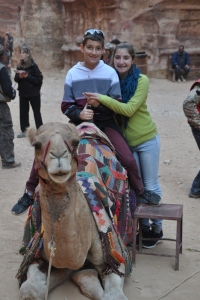 Drew & Noah with a camel at Petra