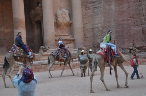 The cousins on camels in front of the big temple in Petra