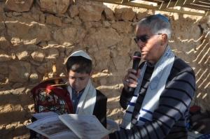 Noah & Rabbi Berman saying the prayer over the Torah.