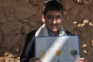 Noah w/ his certificate from the State of Israel.