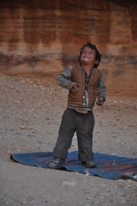 Little boy dancing to the music at Petra