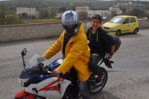 Noah on a motorcycle with one of the teachers