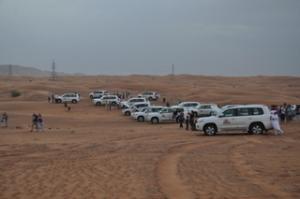 The caravan of cars in the desert