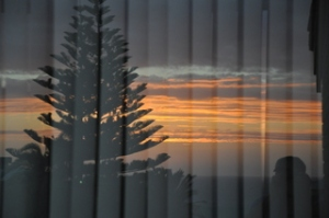 Same sunset reflected in their front window