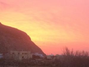 Orange sky at sunrise on Santorini