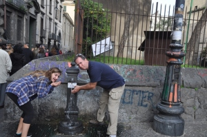 Drew and I drinking from a fountain in the center of Naples