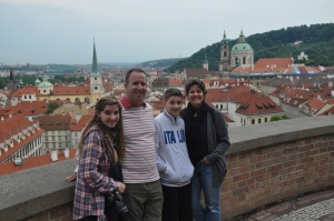 Family at the top of Prague Castle overlooking the city.