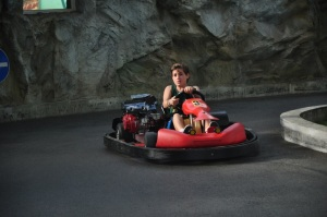 Noah racing go carts at the amusement park
