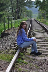 Drew posing on the railroad track just outside Adrspach Park