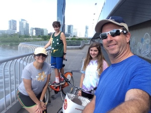 Family on CityBikes on a bridge crossing the Danube