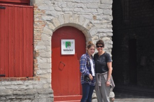Ilise & Drew by the entrance tower to Bruges