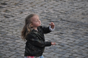 Little girl dancing to the Karioke in Mauer Park